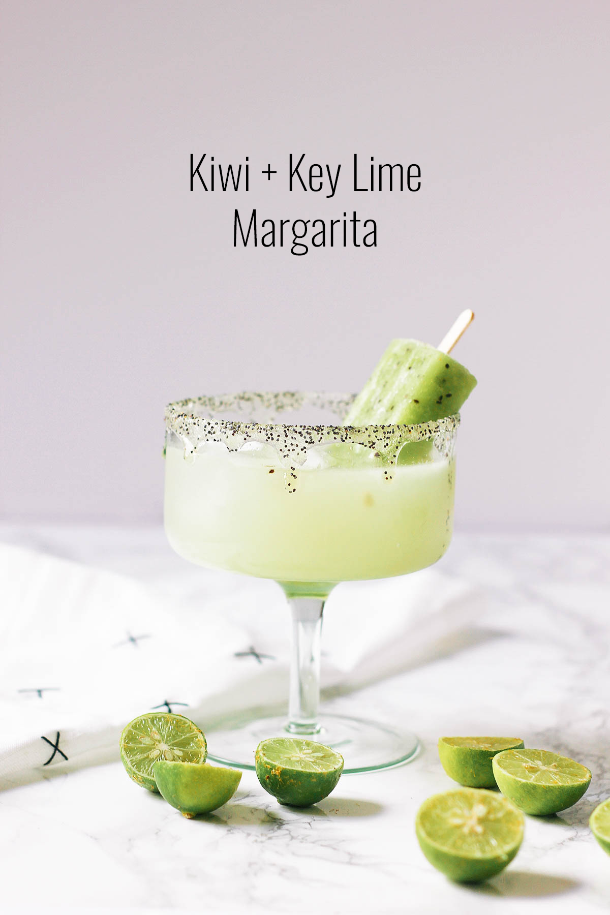 A tropical take on a Cinco de Mayo classic, this margarita is made with kiwi syrup, key limes and topped with a delicious kiwi ice pop.
