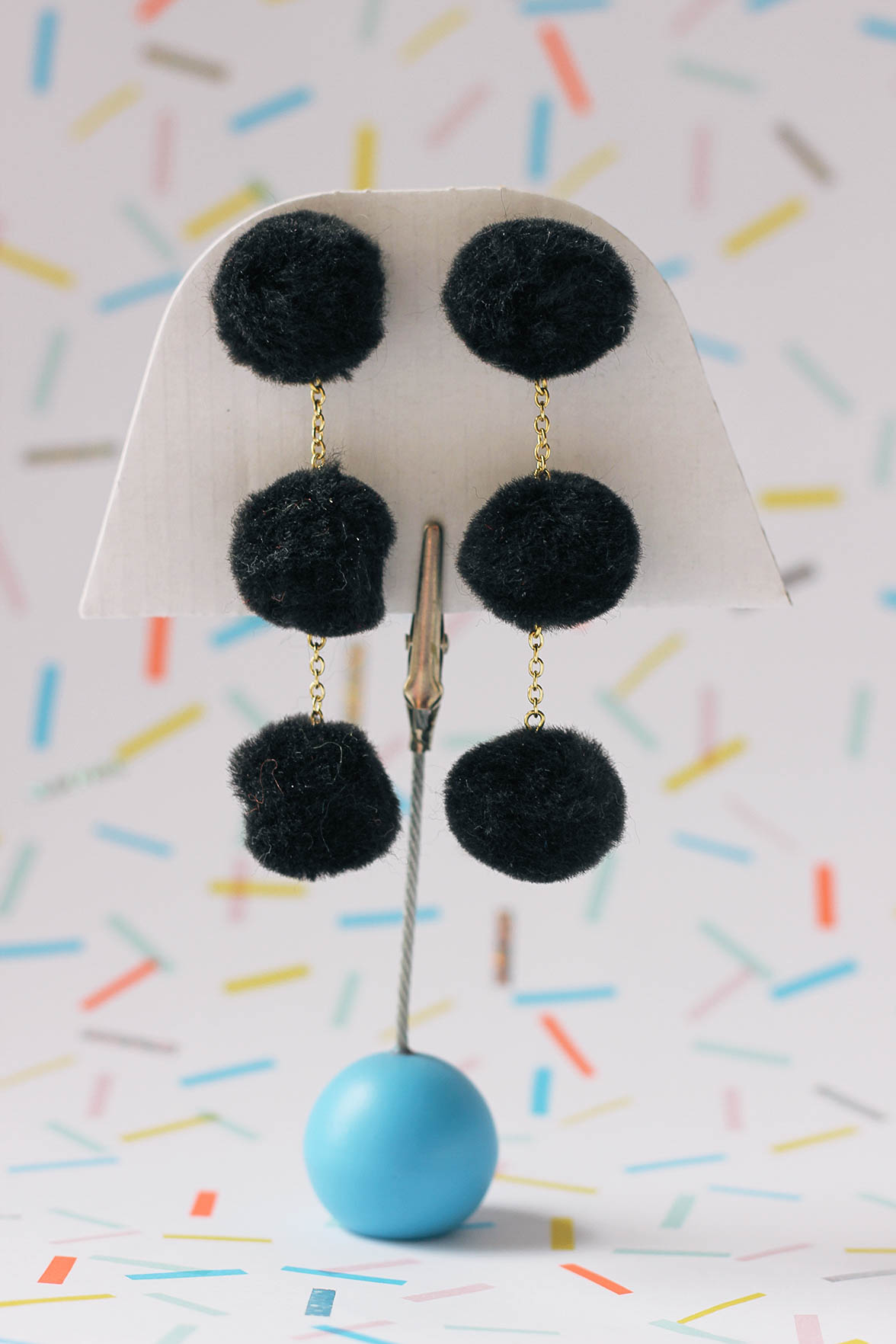 Make these playful (and super lightweight) pom-pom earrings with this easy DIY.