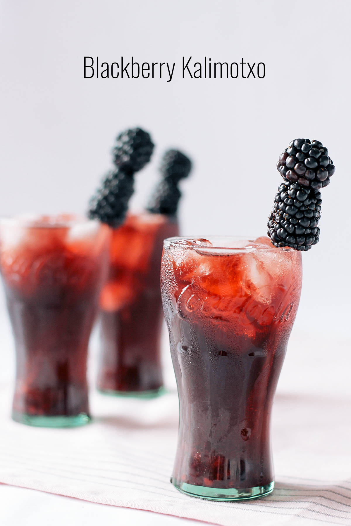 Try this fruity twist on a Basque classic: red wine topped with ice cold soda and some blackberry syrup.