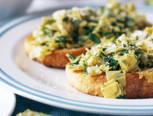 Switch up your go-to toast with a piece of crusty sourdough topped with a zesty mix of artichoke hearts and preserved lemon.