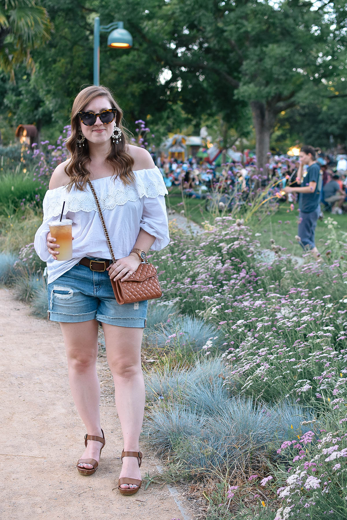 A casual summer look with an eyelet top and ripped denim shorts.