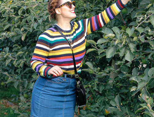 Wear a colorful striped sweater to stay cozy for an apple picking trip this fall.