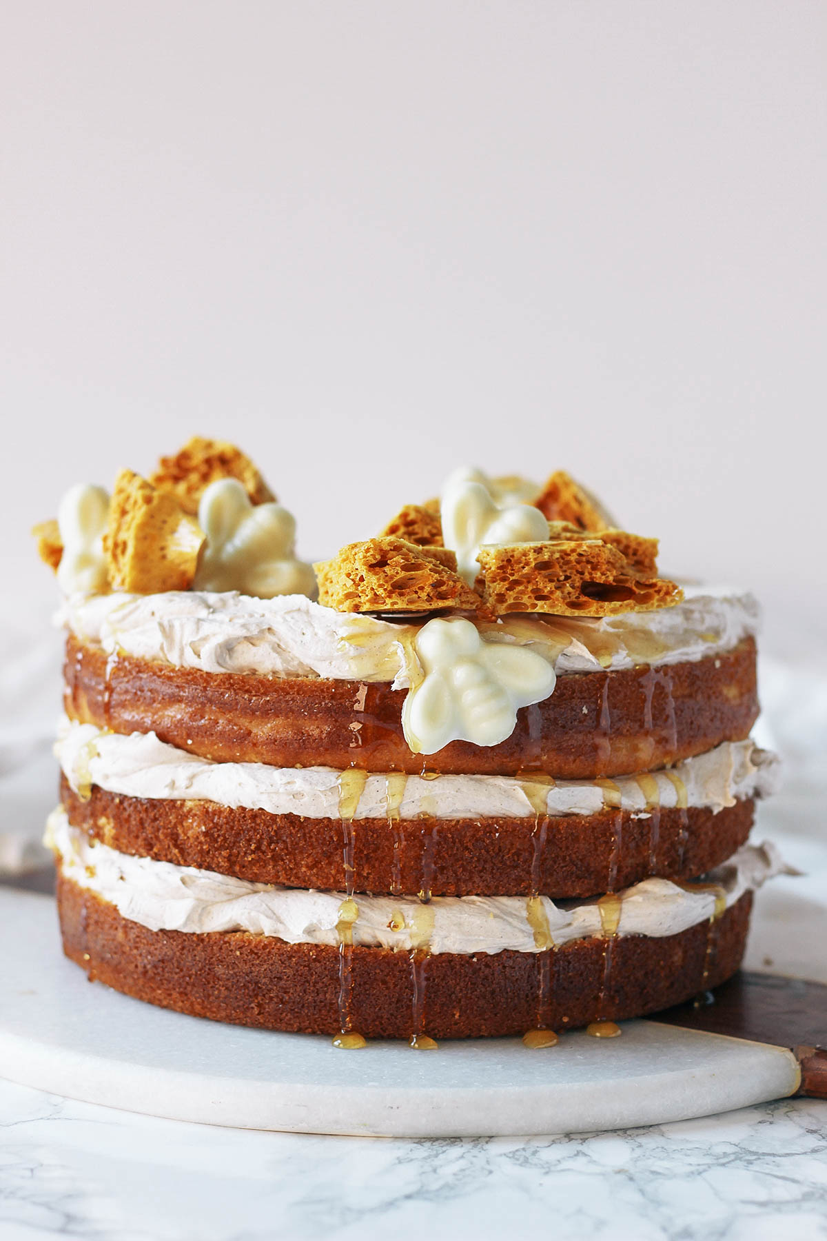 Get the recipe for the perfect naked cake for fall: a cornbread cake topped with cinnamon buttercream and homemade honeycomb.