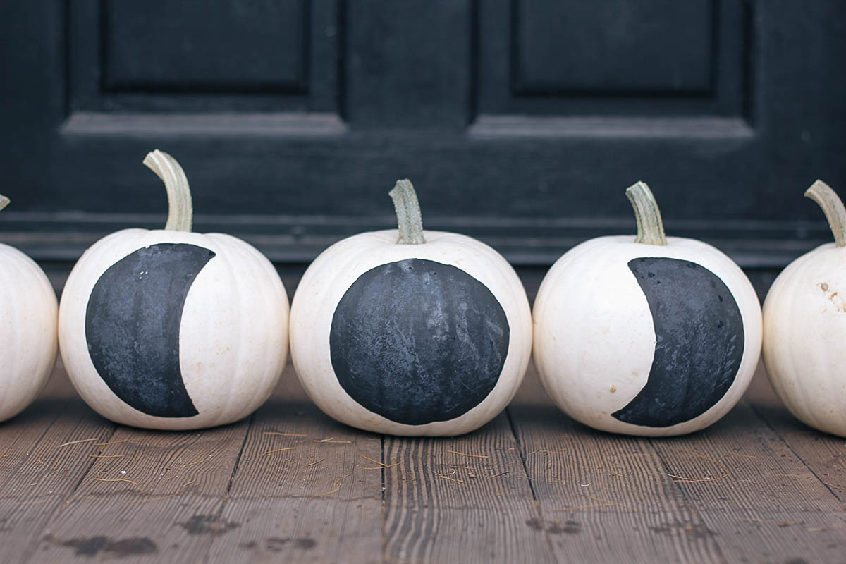 Paint these cute white pumpkins with phases of the moon for a spooky but chic front-porch display.