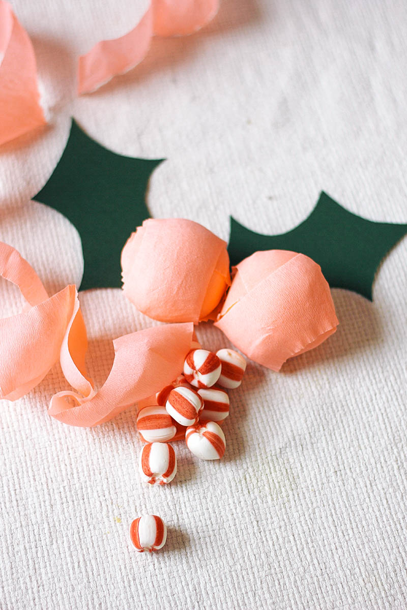 Treat your Christmas guests to these pretty holly berry surprise balls filled with delicious treats. // Get the full tutorial at HomemadeBanana.com