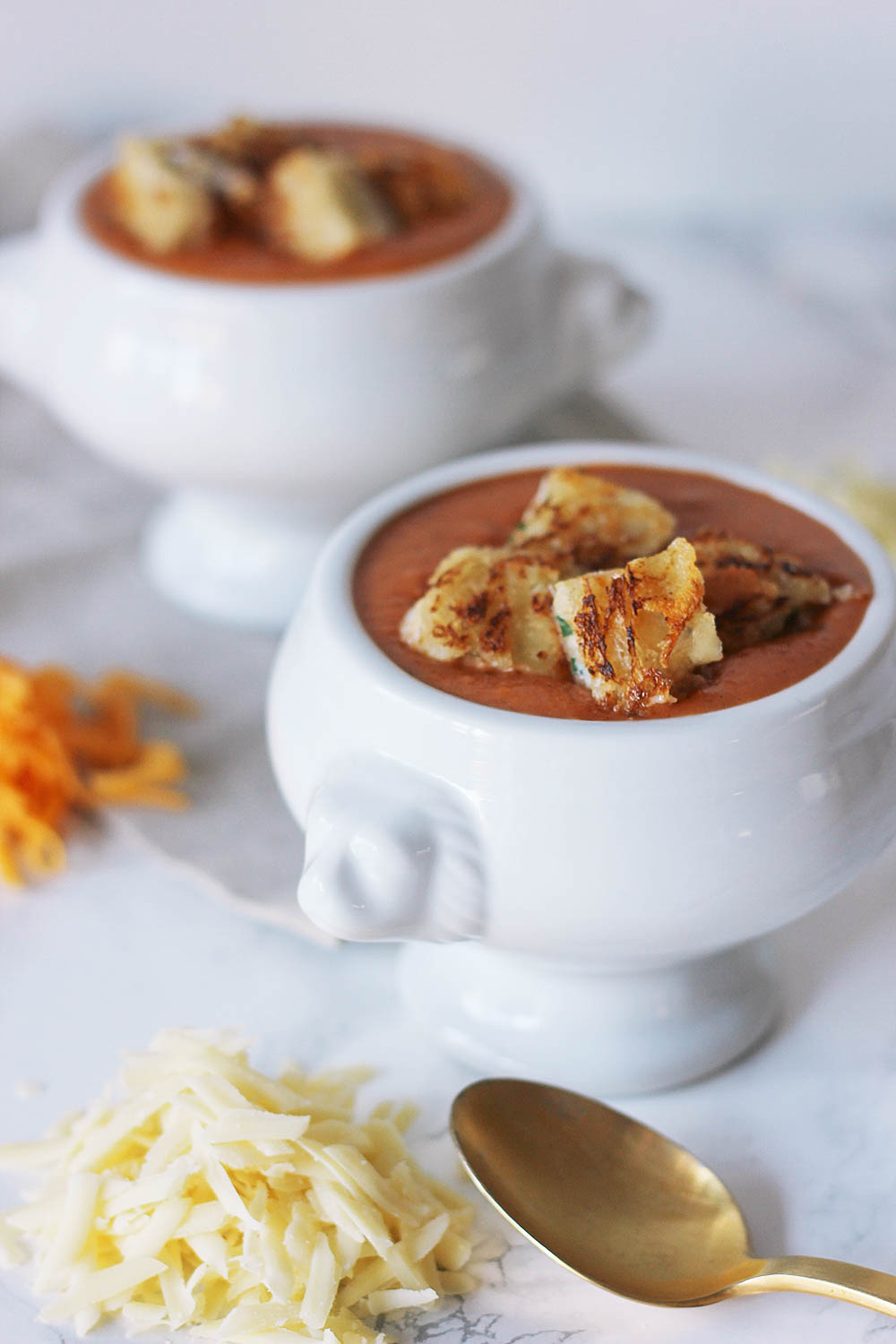 Dress up a delicious bowl of tomato bisque with crab-filled grilled cheese cut into bite-size croutons. Get the full recipe at HomemadeBanana.com