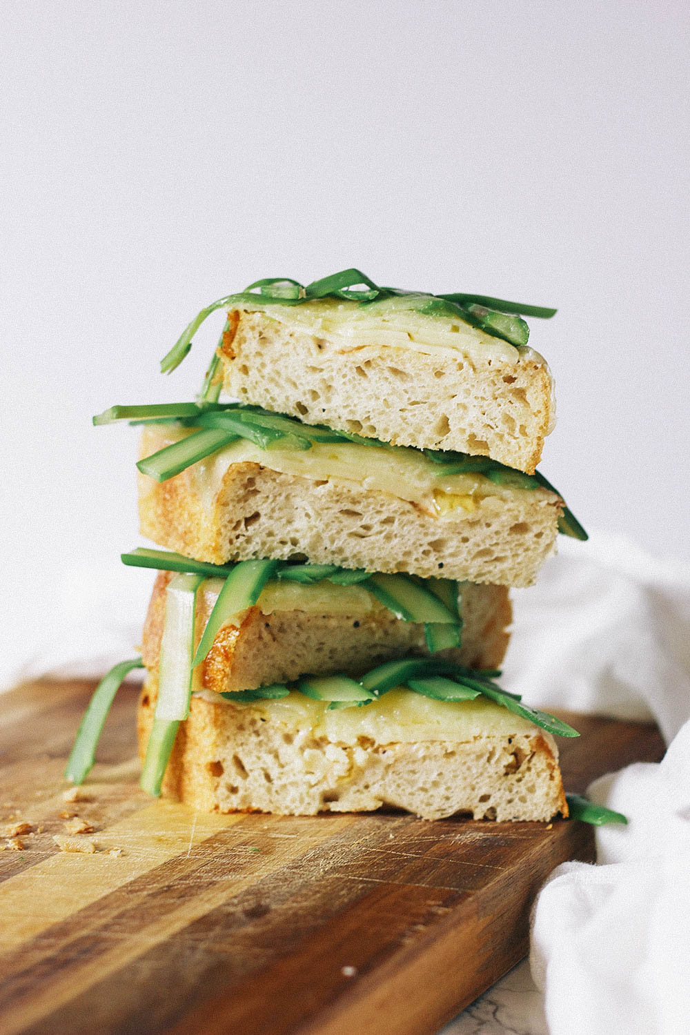 A simply beautiful lunch idea, this thick-cut toast is topped with cheese and thinly sliced asparagus. Get the full recipe at HomemadeBanana.com #lunch #recipe #toast #cheese