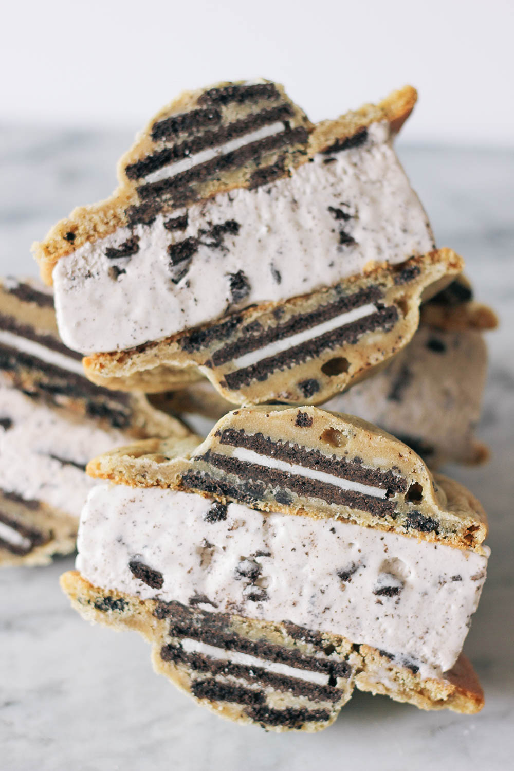 Triple Oreo ice cream sandwiches with Oreos baked right into the cookies. Get the full
